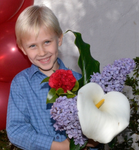 Boy with flowers close crop